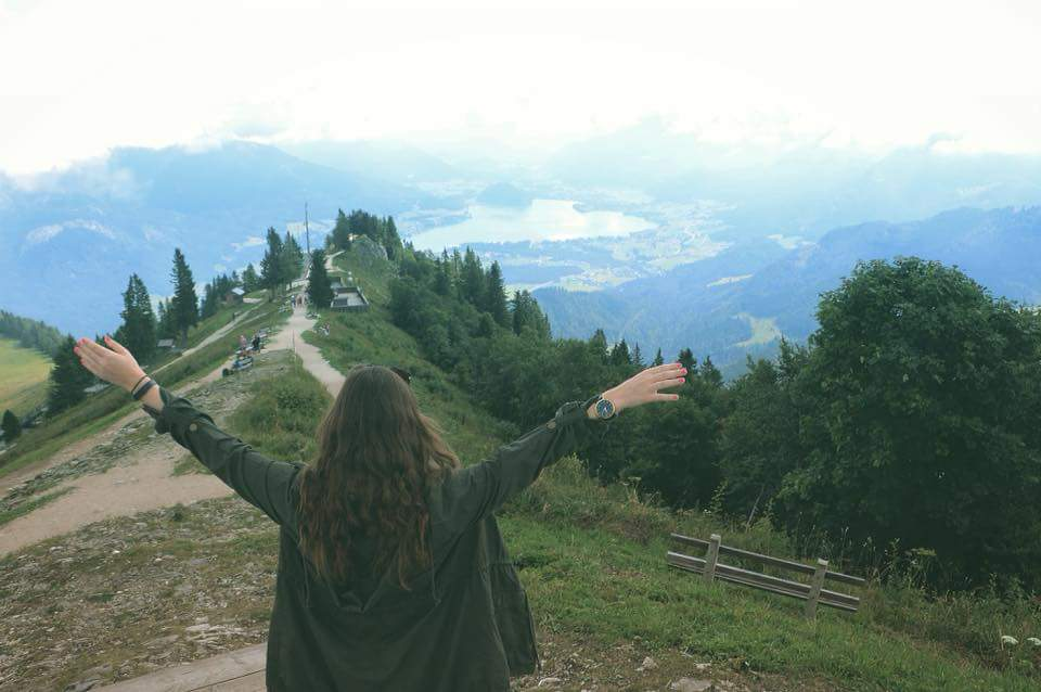 young woman with arms outstretched at Sankt Gilgen, Österreich