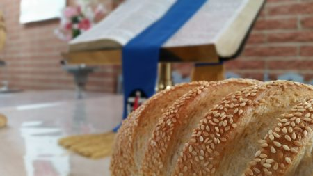 Bread on communion table with Bible in background